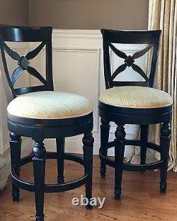 Set of 2 swivel cross back wood counter stools in Antique black finish